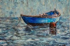 Traditiional fishing boat moored on Obidos Lagoon, Portugal